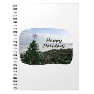 El árbol de navidad contra la playa oscila buenas  libro de apuntes con espiral