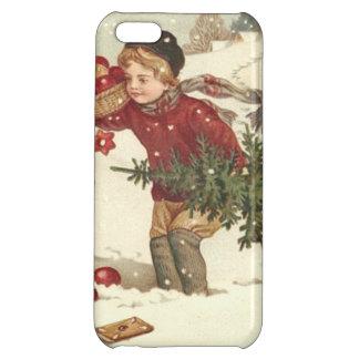 El árbol de navidad del muchacho presenta nieve de