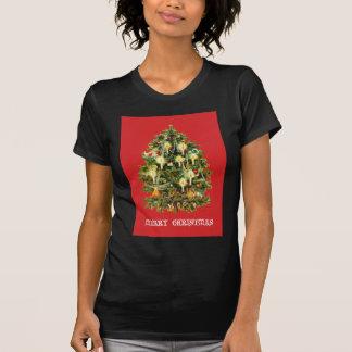 El árbol de navidad iluminado por velas adorna la poleras