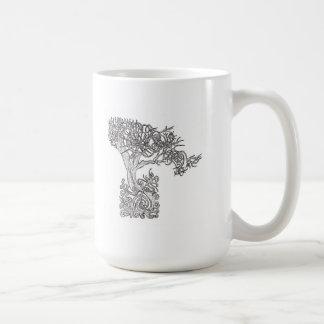 El arbol del sol taza de café