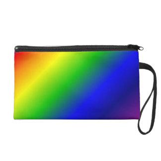 El arco iris colorea el bolso cosmético