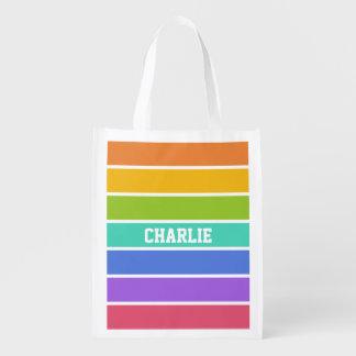 El arco iris colorea el bolso reutilizable del bolsas de la compra