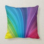 El arco iris colorea la almohada de tiro
