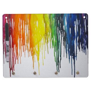 El arco iris derretido dibuja con creyón al tabler pizarras blancas de calidad