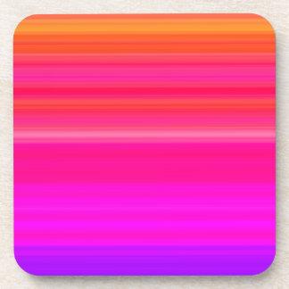 El arco iris mezcla adentro azul y rosado rojos posavasos de bebida