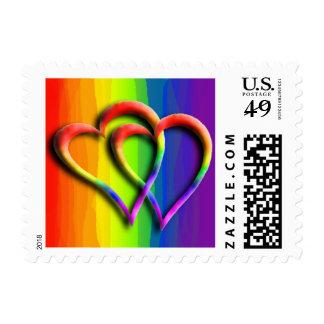 El arco iris unido los corazones gay del boda dos timbres postales