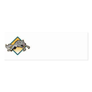 El atacar de salto del perro salvaje del lobo gris tarjeta de negocio
