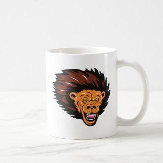 el atacar principal del león enojado tazas