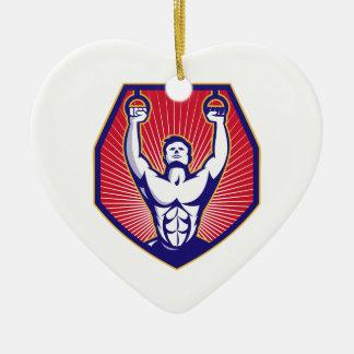 El atleta del entrenamiento suena retro adorno navideño de cerámica en forma de corazón
