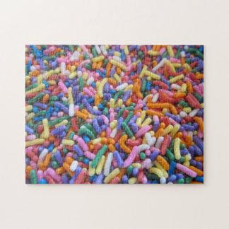 El azúcar asperja puzzle con fotos