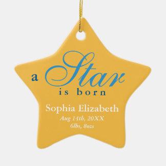 El azul amarillo una estrella es invitación nacida adorno navideño de cerámica en forma de estrella