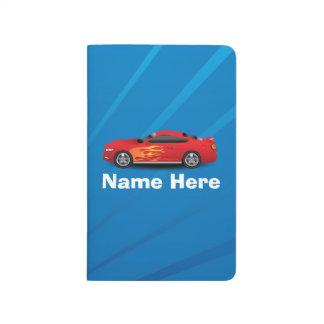 El azul brillante con el coche de deportes rojo cuaderno