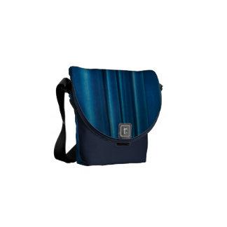 El azul cubre bolsas messenger