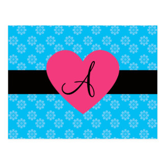El azul florece el corazón del rosa del monograma postal