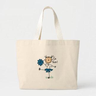El azul va equipo que anima las camisetas y los bolsa tela grande