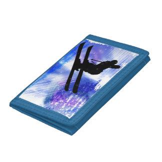 El azul y el blanco salpica con salto de esquí