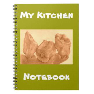 El baile sazona el cuaderno de la cocina con pimie