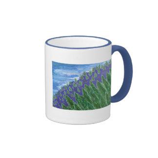 El bajar taza de dos colores