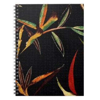 El bambú abstracto sale de negro verde del rojo libros de apuntes