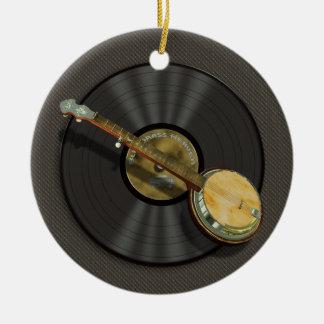 El banjo y el disco de vinilo diseñan alrededor adorno navideño redondo de cerámica