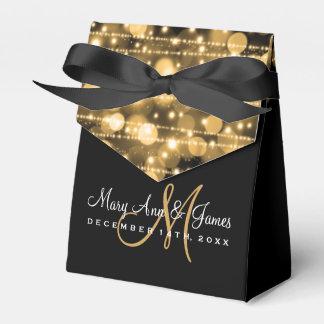 El banquete de boda elegante chispea oro cajas para regalos