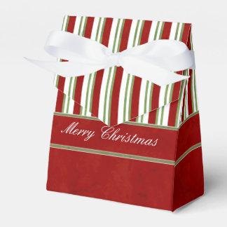 El bastón de caramelo raya rojo rico y el arco caja para regalos