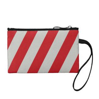 El bastón de caramelo rojo y gris raya los regalos