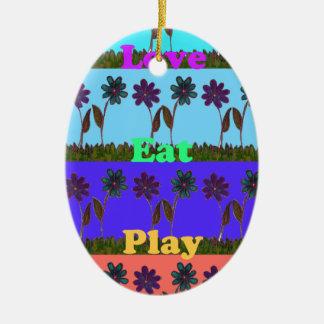 El bebé embroma el juego colors.png del amor adorno ovalado de cerámica