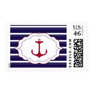 El blanco azul marino náutico raya el ancla roja
