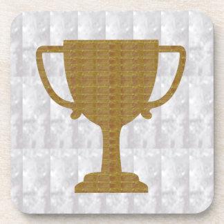 El blanco cristalino del trofeo del ORO añade Posavasos