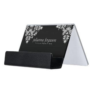 El blanco moderno remolina sobre fondo negro caja de tarjetas de visita para escritorio