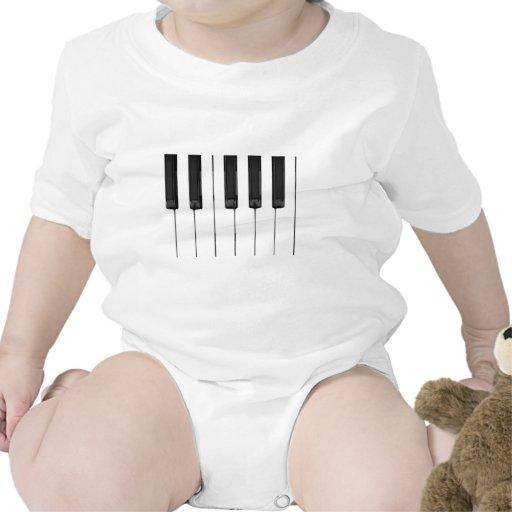 El blanco negro cierra el teclado de la música traje de bebé