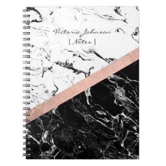 El bloque de mármol blanco negro elegante del notebook
