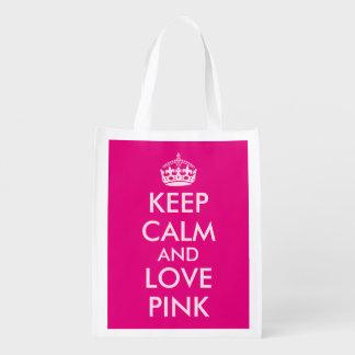 El bolso de compras rosado guarda calma y ama bolsas de la compra