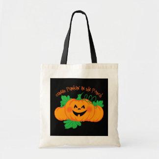 El bolso más lindo del truco o de la invitación de bolsas lienzo
