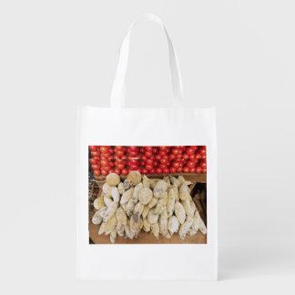 El bolso reutilizable se libra de las bolsas de bolsa de la compra