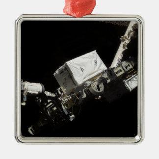 El brazo robótico del sistema de manipulante adorno cuadrado plateado