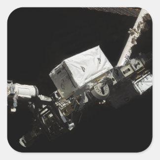 El brazo robótico del sistema de manipulante calcomanía cuadrada