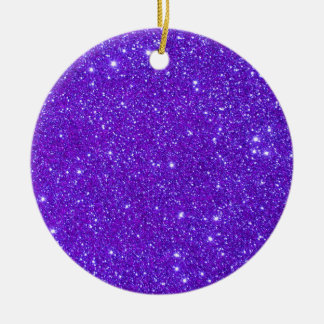 El brillo púrpura de la chispa crea sus los adorno redondo de cerámica