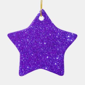 El brillo púrpura de la chispa crea sus los adorno de cerámica en forma de estrella
