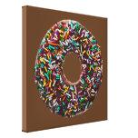 El buñuelo del chocolate con colorido asperja impresiones de lienzo