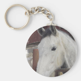 El caballo árabe blanco representa llavero