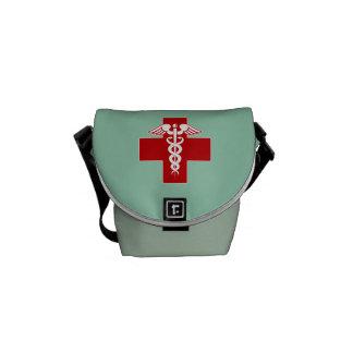 El caduceo de la enfermera friega verde bolsa messenger