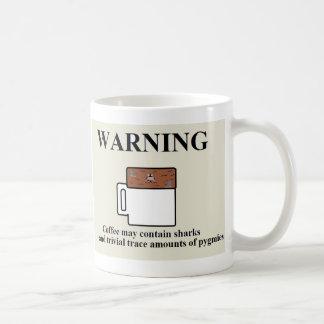 El café puede contener tiburones y a pigmeos tazas de café