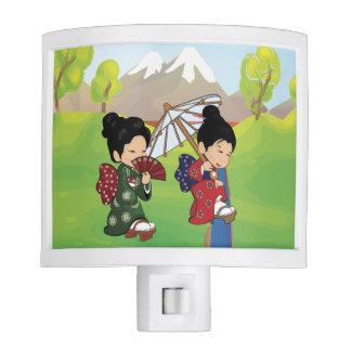 El caminar japonés lindo de los chicas lámparas de noche
