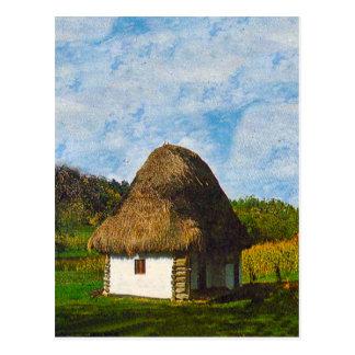 El campesino tradicional cubrió con paja la cabaña postales