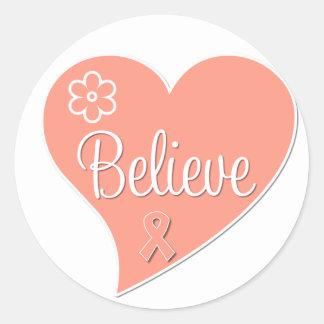 El cáncer uterino cree el corazón pegatina redonda