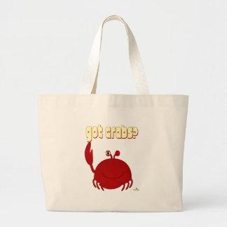 El cangrejo rojo sonriente consiguió cangrejos bolsa de mano