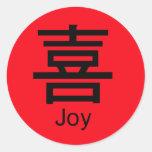 El carácter chino para la alegría etiqueta redonda
