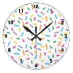 El caramelo colorido del helado asperja reloj